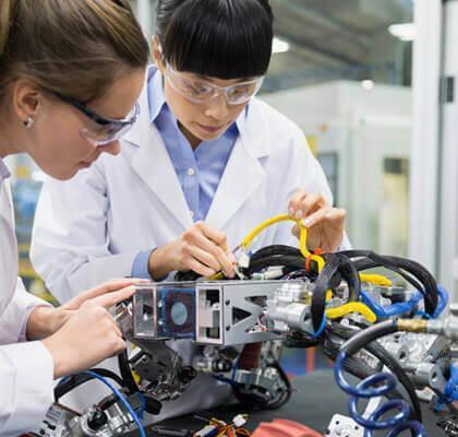 Women engineers working on device